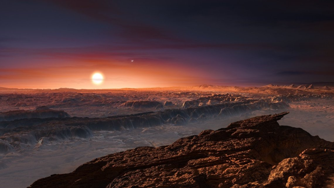 This artist's impression shows a view of the surface of the planet Proxima Centauri b orbiting the red dwarf star Proxima Centauri, the closest star to the Solar System. The double star Alpha Centauri AB also appears in the image to the upper-right of Proxima itself. Proxima b is a little more massive than the Earth and orbits in the habitable zone around Proxima Centauri, where the temperature is suitable for liquid water to exist on its surface.