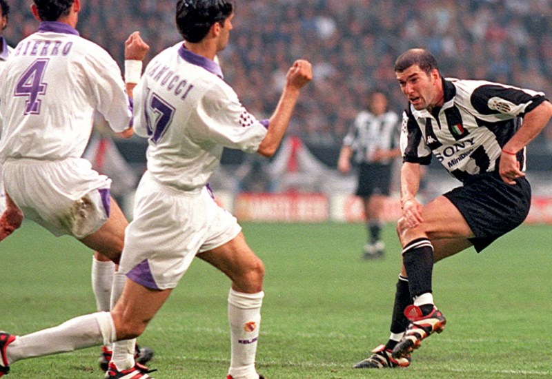20 May 1998 - Uefa Champions League Final - Juventus v Real Madrid - Zinedine Zidane of Juventus has a shot with Fernando Hierro of Madrid in the way.