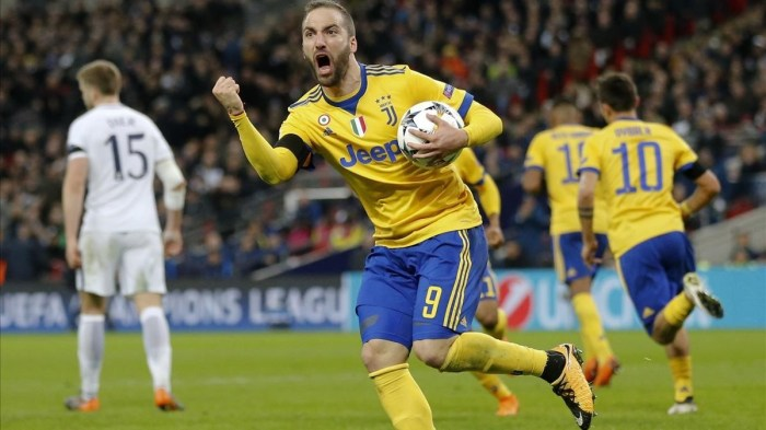 Juventus Gonzalo Higuain celebrates after scoring his side first goal during the Champions League round of 16 second-leg soccer match between Juventus and Tottenham Hotspur at the Wembley Stadium in London Wednesday March 7 2018 AP Photo Frank Augstein