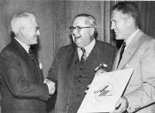 Hudson's A. E. Barit celebrates the birth of American Motors with Nash's George Mason and George Romney  Image source: inforum.com