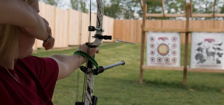 Harley Klee, an assistant manager and coach at Koteewi, fires an arrow at one of the targets.