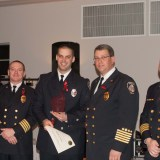 From left Deputy Chief Jeff Beam, Justin Pataky (holding his award), Fire Chief James VanGorder and Deputy Chief Brian Miller. (Submitted photo)
