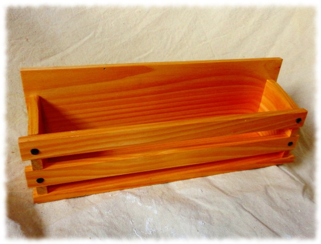 Book display made from pine and finished with clear shellac.