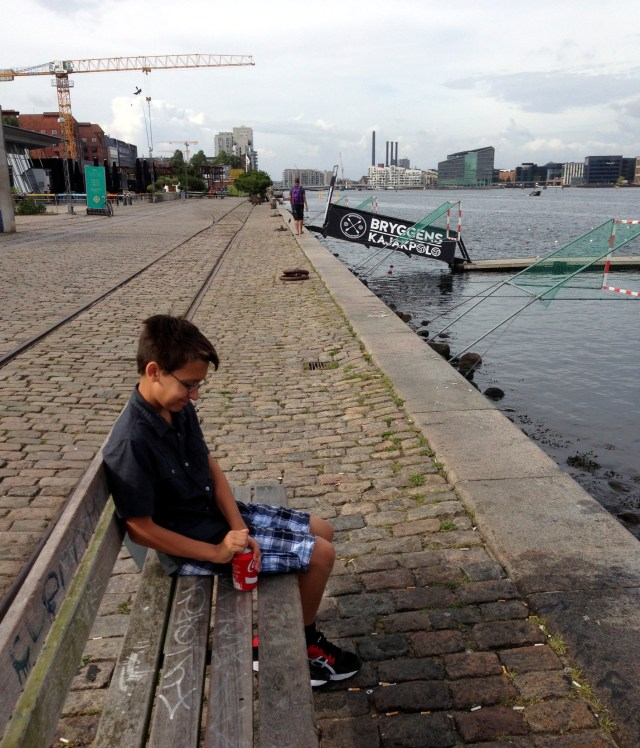Ben taking a Coke break along the canal in front of our apartment