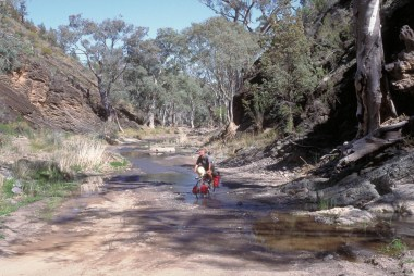 The road follows the river bed