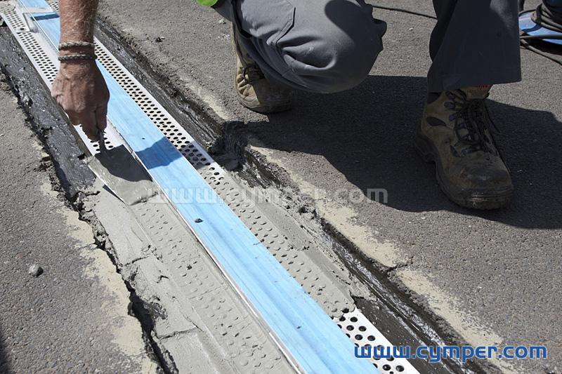 Reparación de junta de dilatación en pavimento asfáltico - 08