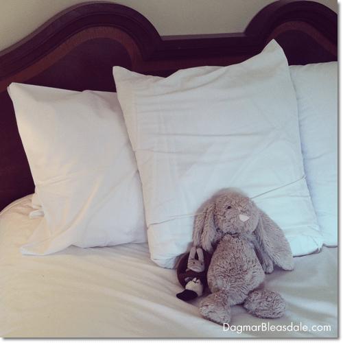stuffed animals on hotel bed