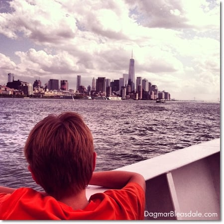 boy on Circle Line Ferry, looking at Freedom Tower, New York