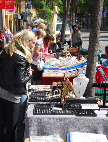 Passersby stop and look at the latest trinkets on display on Telegraph Avenue.