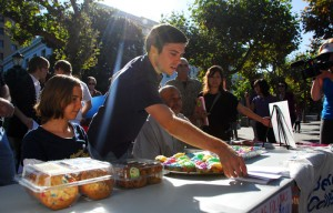 Shawn Lewis (center), the president of the Berkeley College Republicans, and former UC Regent Ward Connerly (behind Lewis) support the 'Increase Diversity Bake Sale.' The bake sale aimed to satirize SB 185 — affirmative action-like legislation — through a proposed price structure based on race and sex.