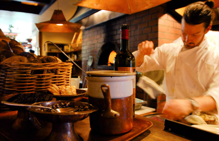 A chef working at Chez Panisse.
