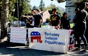 """Shawn Lewis, the President of the Berkeley College Republicans, helps set up the """"Increase Diversity Bake Sale"""" last Tuesday morning."""