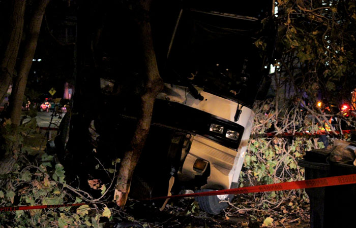 A charter bus crashed into a tree near the intersection of Hearst Avenue and Spruce Street on Friday evening.