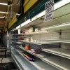 The last few items sit on the mainly empty shelves of the Andronico's location on University Avenue.
