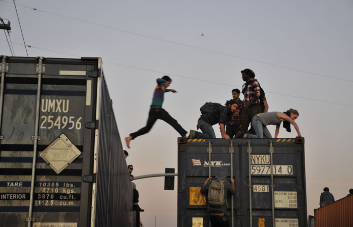 A protester jumps from one semi trailer to another. Protesters stopped semi trucks along the approaches to the port.
