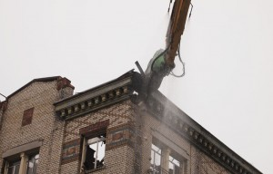 The fire-damaged building at the corner of Haste Street and Telegraph Avenue is being demolished.