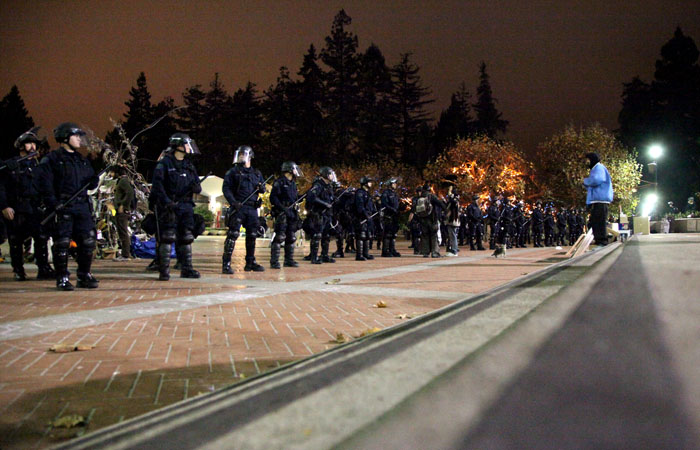 Police stood in a line facing the steps of Sproul Hall as an order was given for the protesters to clear the encampment.