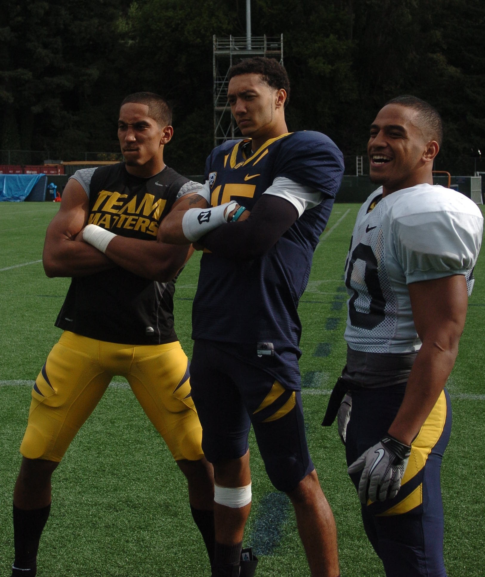 Sean Cattouse, Zach Maynard and Isi Sofele pose for the camera.
