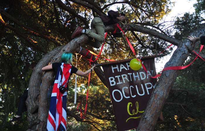 Members of Occupy Cal set up across from Chancellor Robert Birgeneau's house for the one-month anniversary of the start of Occupy.