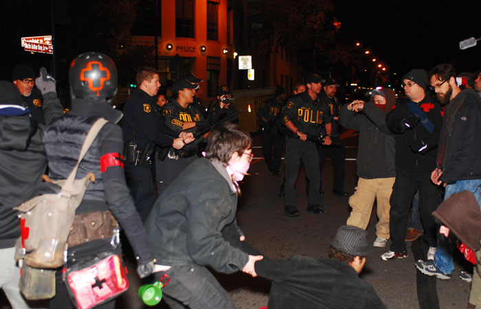 Police face protesters near Martin Luther King Jr. Civic Center Park.