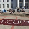 Protestors restart the occupation of Sproul with several tents, banners and signs.