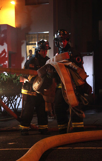 Firefighters ready hoses at the apartment fire on Nov. 18.
