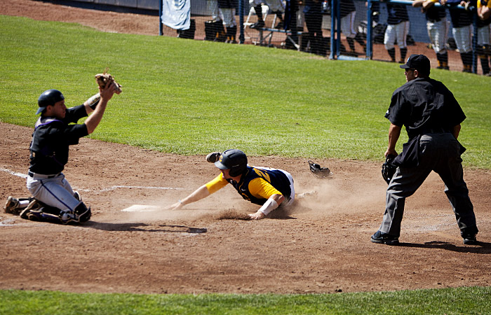 Cal catcher Chadd Krist is tagged out as he attempts to slide home.