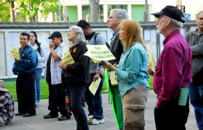 Community members gathered outside of the City hall to protest against the mutual aid agreement under debate at the Tuesday night meeting.