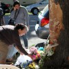 Mourners lay flowers at the tree that the car allegedly driven by Jose Lumbreras collided with, the impact of which left 2012 UC Berkeley graduate Milanca Lopez dead and her son seriously injured.