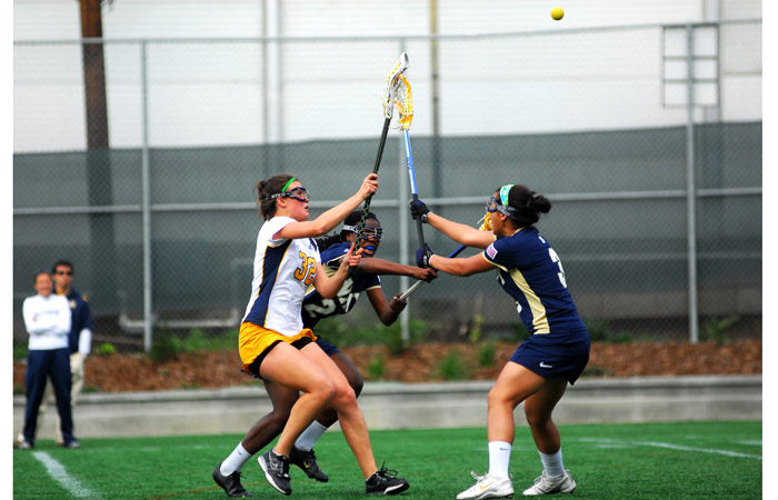 Megan Takacs (32) set Cal's single-season goals record in an Apr. 12 win at Vermont. But the MPSF Player of the Year's season ended when she injured her knee, and the Bears lost their remaining three games by a combined margin of 14 goals.