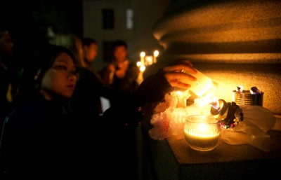 Students leave candles and other items in remembrance of Treadway on the Sproul steps.