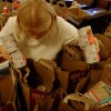 Linda McArdell, Volunteer Coordinator of the Berkeley Food and Housing Project Food Drive packs bags with donated food that will be given to families or individuals in need.