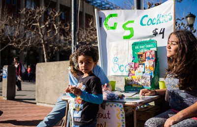 These girl scouts have positioned their kiosk at a very popular spot on the corner of Bancroft Avenue and Telegraph Avenue.