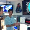 UC Berkeley scientists Jeremy Thorsness (left) and Thomas Immel discuss the ICON satellite mission operations at a campus lab.
