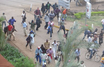 Crowd fleeing sounds of gunfire near Westgate shopping mall.