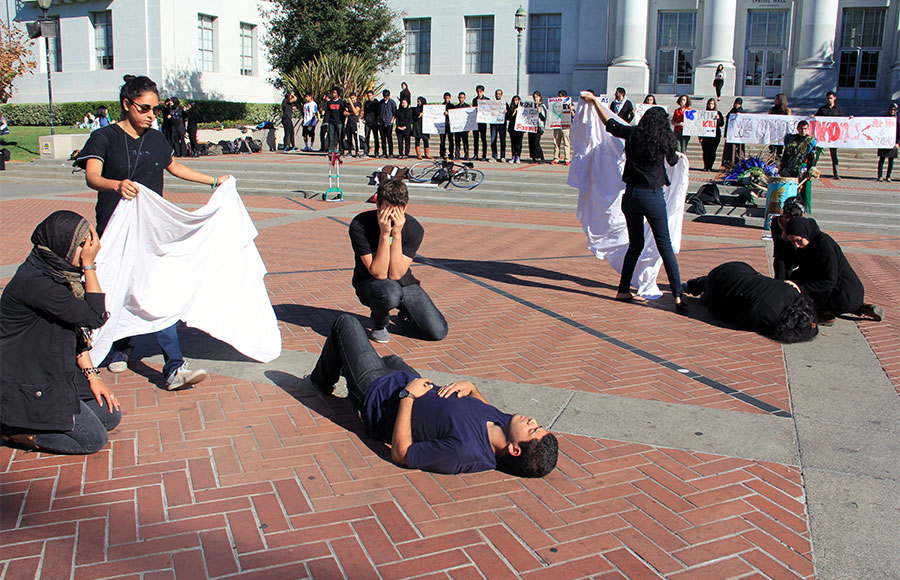 Members of the UC Berkeley Muslim Student Association protest  government drone use on the steps of Sproul Hall on Wednesday.