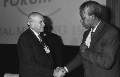 Nelson Mandela shakes hands with former South African President F.W. de Klerk in the World Economic Forum at Davos, Switzerland in 1992.