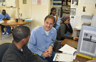 Arnulfo Garcia, center, editor in chief of the San Quentin News, works in the newsroom at Marin County's San Quentin State Prison.