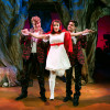 Wolves (Ryan McCrary and Jeffrey Brian Adams) meet Little Red Ridinghood (Corinne Proctor) in the woods.