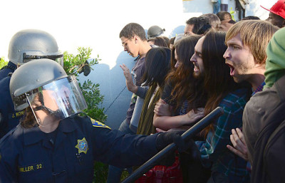 UCPD officers hold batons during a protest in front of Sproul Hall on Nov. 9, 2011.