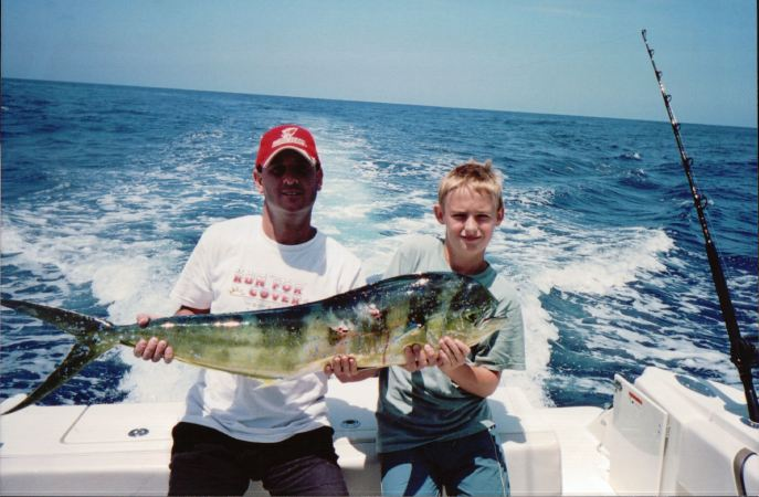 Leininger, right, is pictured here with his uncle, Jeff Leininger, after catching a dolphin fish in 2005.