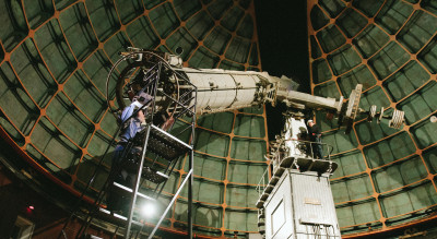 Paul Lynam and Patrick Maloney operate the Great Lick Refractor, completed in 1888, for a student tour in May. Photo: Lorenz Angelo Gonzales/Staff