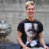 Ole Kavli, a student from Norway, sits in the International House courtyard.
