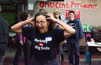 Vicki Alexander, co-chair of Yes on D, reacts to the first wave of precinct results that reported early support for the 'soda tax.'