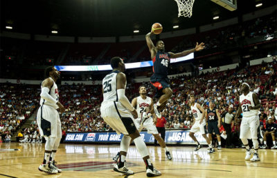 Harrison Barnes, USA Men's Blue team player, goes up for a dunk during the first half of the USA Blue vs. White Basketball game at the Thomas and Mack Center, July 25, 2013, in Las Vegas. Barnes scored 18 points for the Blue team. The USA Basketball Association invited four airmen from Nellis and Creech Air Force Bases who recently came home from deployment and one, a wounded warrior, to recognize them during the game. (U.S. Air Force photo by Senior Airman Daniel Hughes)