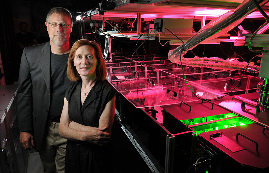 Physics Professors Margaret Murnane, right, and Henry Kapteyn of JILA pose next to one of their laser apparatuses in their laboratory at the University of Colorado Boulder campus on August 25, 2010.  (Photo by Glenn Asakawa/University of Colorado)