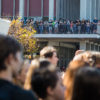 Campus-goers gather on the balcony of UC Berkeley's Martin Luther King, Jr. Student Union to watch as protestors gather across Sproul Plaza on Wednesday, November 9, 2016 in Berkeley, Calif. (Rachael Garner/Senior Staff)