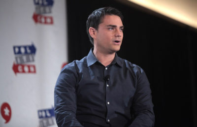 ben shapiro, national right-wing pundit, sits on stage