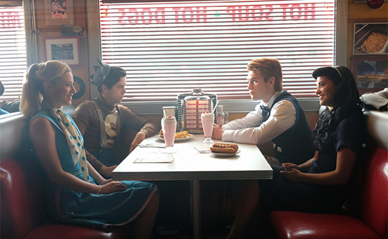 "Riverdale -- ""Chapter Fifteen: Nighthawks"" -- Image Number: RVD202a_0453.jpg -- Pictured (L-R): Lili Reinhart as Betty Cooper, Cole Sprouse as Jughead Jones, KJ Apa as Archie Andrews, and Camila Mendes as Veronica Lodge -- Photo: Bettina Strauss /The CW -- © 2017 The CW Network. All Rights Reserved"