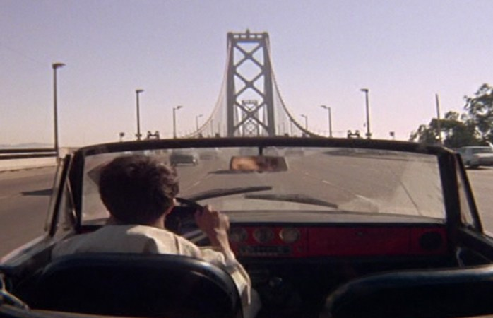 Benjamin drives over the Bay Bridge